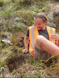 Eron examines a soil pit